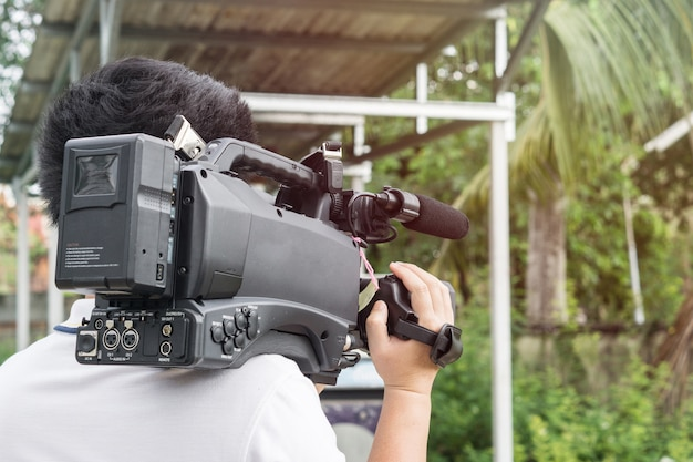 ., videographer takes video camera with free copy spa