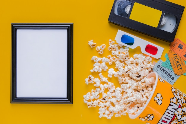 Videotape with popcorns and a frame