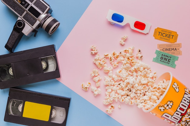 Videotape with vintage videocamera and popcorns