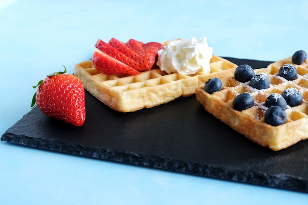 Viennese or belgian waffles with strawberries and whipped cream