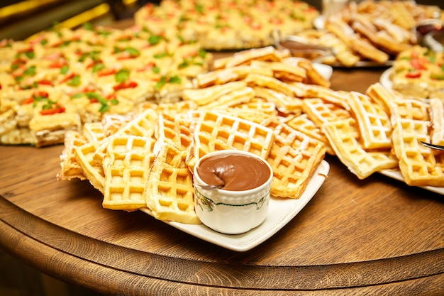 Viennese waffles with jam and chocolate on event catering