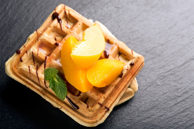 Viennese waffles with peaches and chocolate
