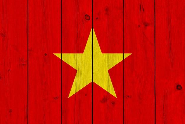 Vietnam flag painted on old wood plank