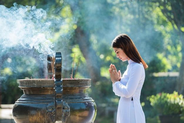 Vietnam girl pray in thien mu  temple hue town