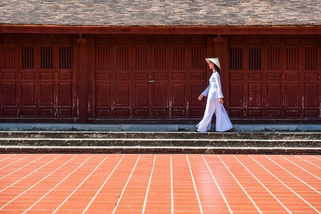 Vietnam girl walk in thien mu  temple hue town