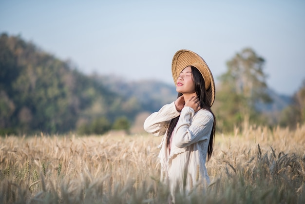 Vietnamese female farmer wheat harvest