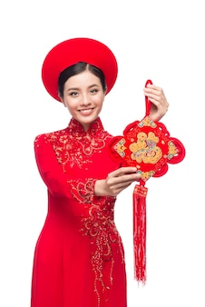 Vietnamese new year woman wearing aodai celebrates tet holiday