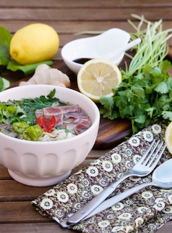 Vietnamese noodle soup with broth