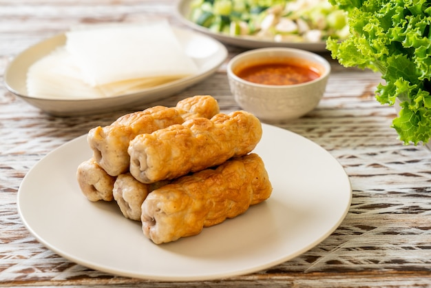 Vietnamese pork  meatball with vegetables wraps (nam-neaung or nham due) - vietnamese traditional food culture