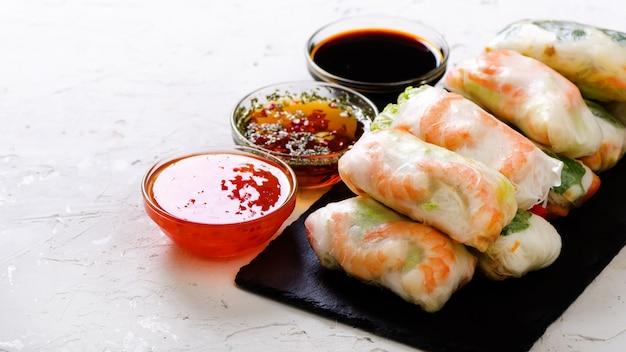 Vietnamese spring rolls - rice paper, lettuce, salad, vermicelli, noodles, shrimps, fish sauce, sweet chili, soy, lemon