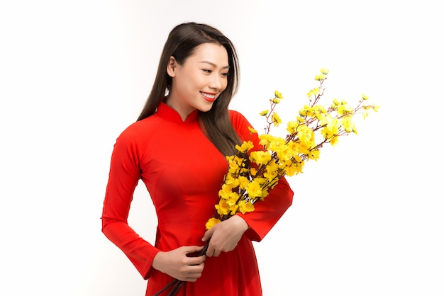 Vietnamese woman holding flower means happy new year