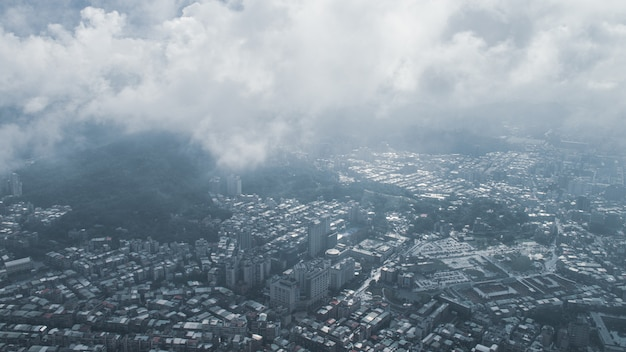 The view across taipei, capital of taiwan, from the top of taipei 101, the second largest building in the world,shoot after raining with fog.