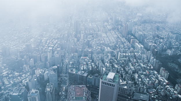 The view across taipei, captial of taiwan, from the top of taipei 101, the second largest building in the world,shoot after raining with fog.