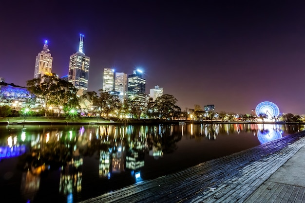 A view across the yarra river atthe landmark of melbourne downtown during the city's nig