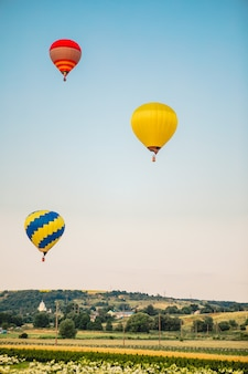 View of air balloon with basket flies on sunset copy space