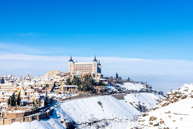 View of the alcazar of toledo covered by snow.
