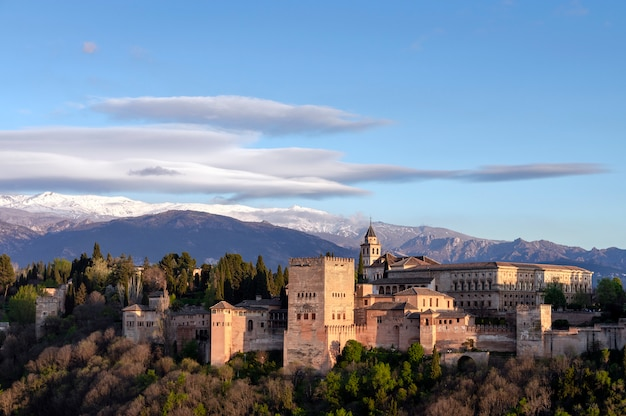 View of the alhambra in granada with sierra nevada in the background, granada, spain