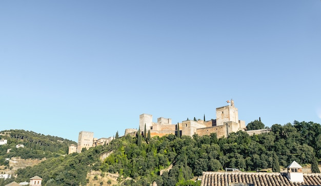 View of the alhambra palace from the carvajales viewpoint. blue sky for copy space or collage