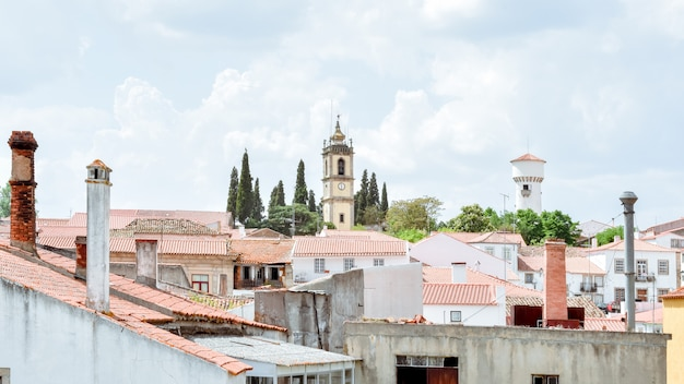 View of almeida, portuguese village. towers and crosses on the town's skyline.