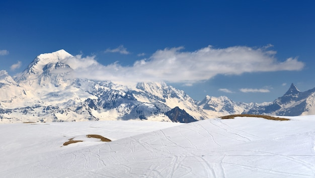 View on alpine peak mountains coevred with snow