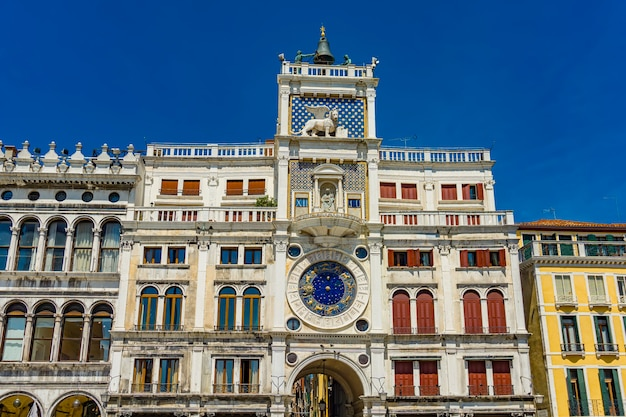 View at ancient clock torre dell'orologio in san marco square in venice, italy