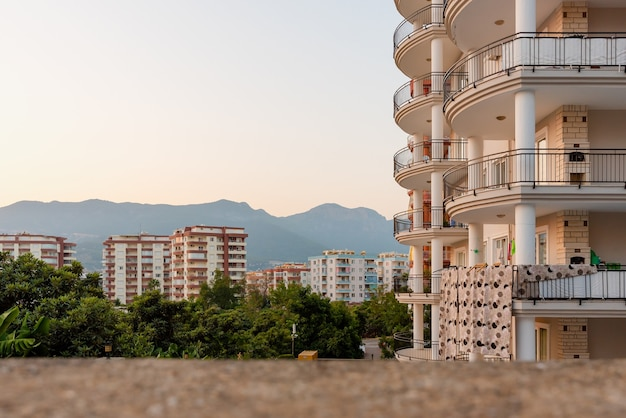 View of apartment buildings and surroundings in the city of alanya against the backdrop of mountains. real estate and construction industry in turkey.