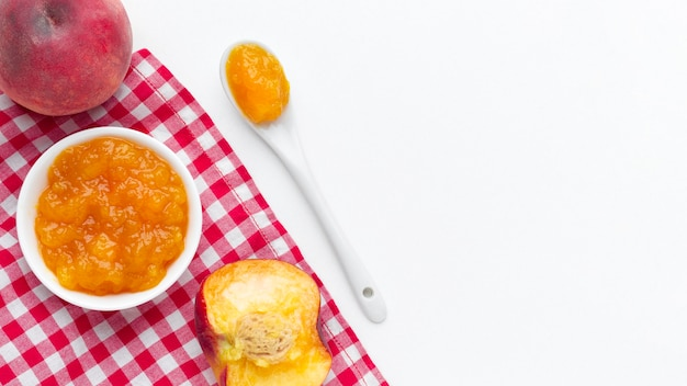 Above view apricots jam on bread