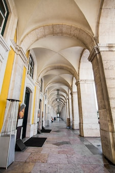 View of the arcades of the commerce plaza located in lisbon, portugal.
