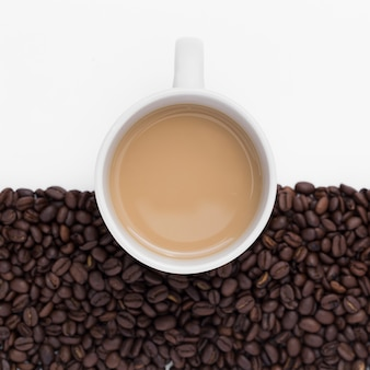 Above view arrangement with coffee cup and beans