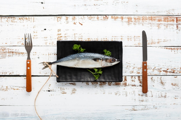 Above view arrangement with fish and tableware