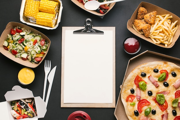 Above view arrangement with food and clipboard