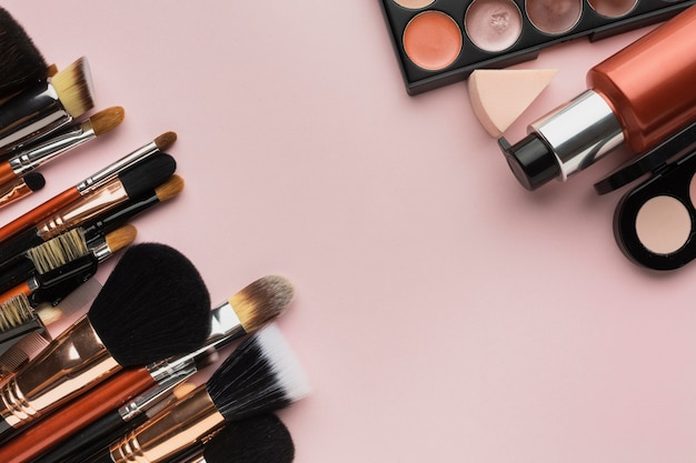 Above view arrangement with make-up brushes and products