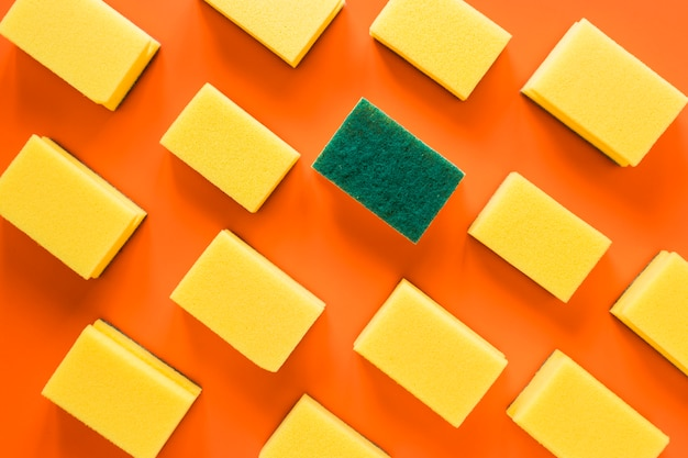 Above view arrangement with sponges on orange background