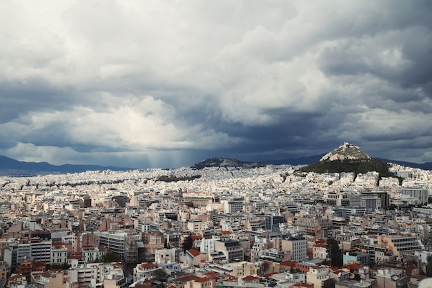 View of athens, greece. view of the lycabettus.stormy and rainy sky.