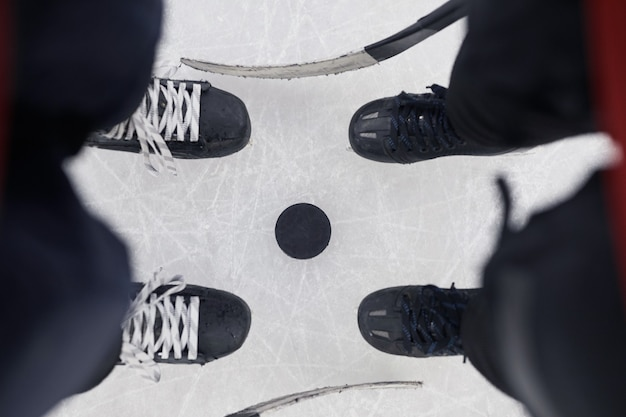 Above view background of two unrecognizable hockey players standing