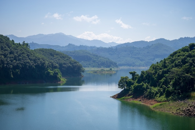View of bang lang dam water between two mountains and clear blue sky.