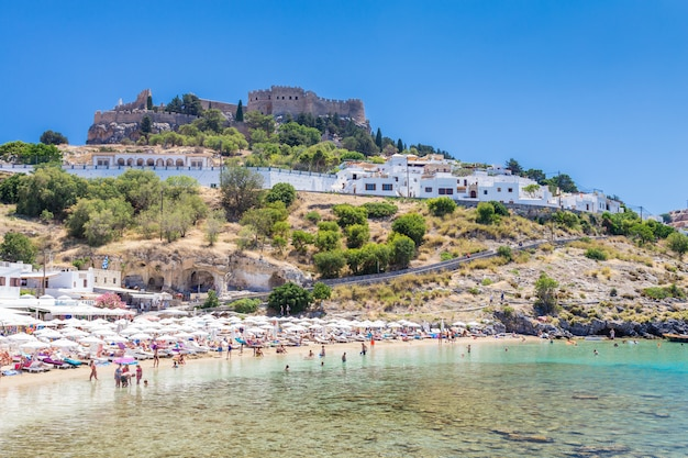 View of the beach ant the fortress in lindos town. rhodes, greece