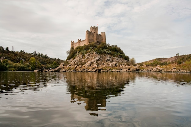 View of the beautiful almourol castle located on a small island on the middle of the tagus river, portugal.