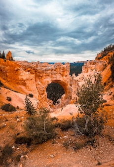 View of the beautiful the arch grand escalante in bryce national park from the viewpoint. utah, united states, vertical photo