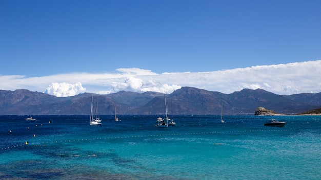 View of beautiful nature seacape of the corsica island, france, clouds sky background. horizontal view.