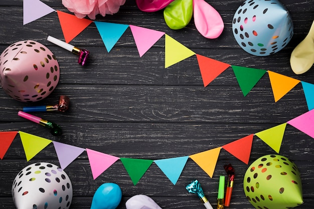 Above view birthday decorations on wooden background
