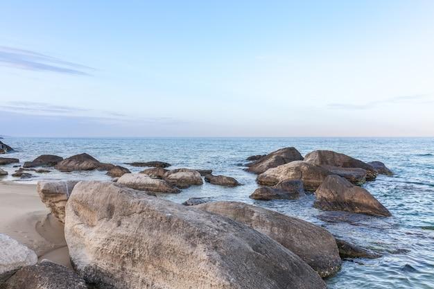 View of blue sea waves at rocky beach. horizon line. caspian sea, sandstone coast