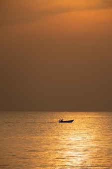 View of boat floating over the sea with sunrise