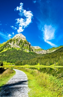 View of brunnelistock mountain at obersee lake in the swiss alps