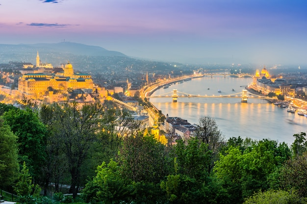 View of budapest from gellert hil with buda castle, danube with szechenyi bridge and marga