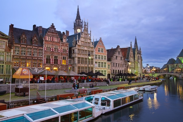 View of buildings with tourboats moored, ghent, belgium