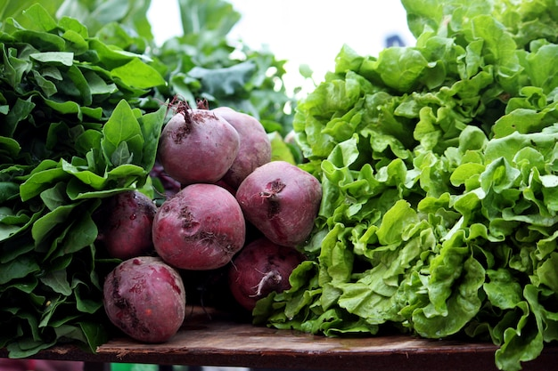 View of a bunch of fresh beet root and lettuce vegetables on the market.
