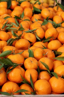 View of a bunch of tangerines on the street market.