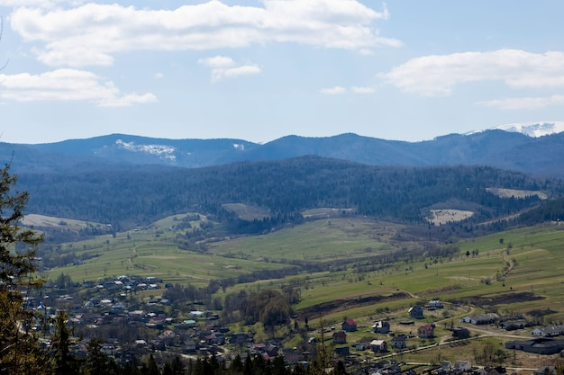 View of the carpathian mountains landscape in cloudy summer day.