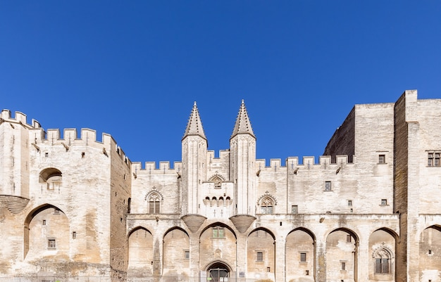 View of the castle facade of palace of the popes in the city of avignon